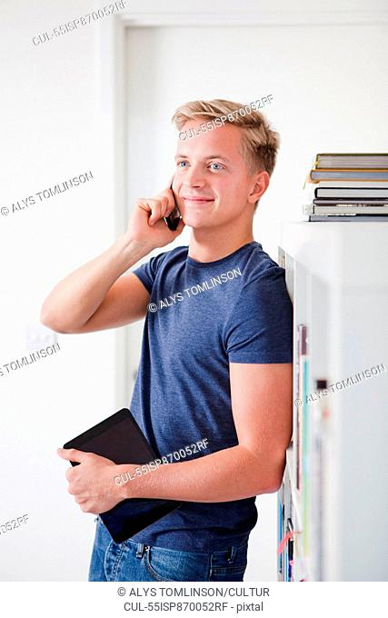 Male student on cell phone