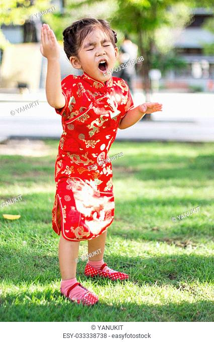 asian thai girl in chinese dress suite in kungfu action on park