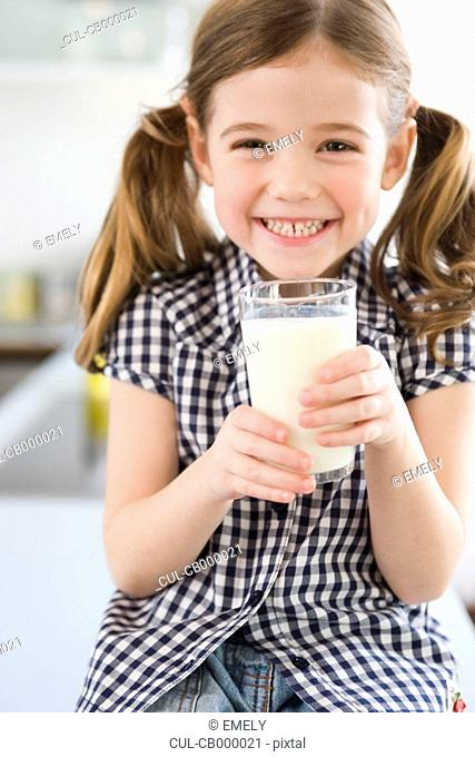 Girl smiling at camera holding glass