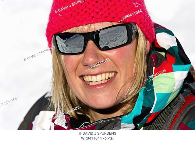A winter sports enthusiast having fun in the sun and snow