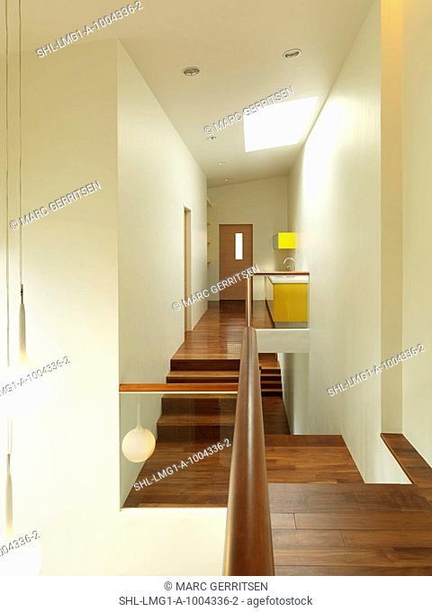 Modern hallway with hardwood floors
