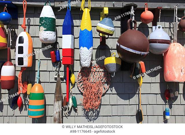 Group of buoys on facade made of shingles at fishing shack at Peggys Cove, Nova Scotia, Canada
