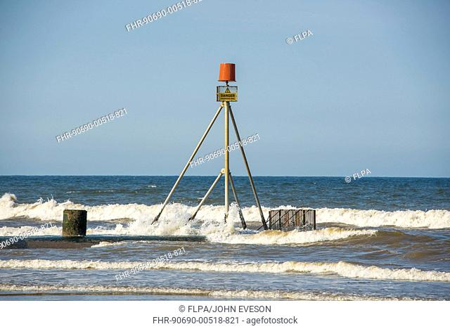 'Danger, Hazardous Area' sign on drainage outfall into sea, Anderby Creek, Lincolnshire, England, June