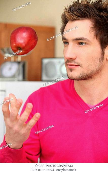 Man catching apple