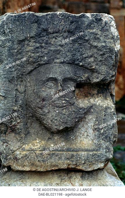 Relief representing a mask, ancient Roman city of Tiddis, Algeria. Roman civilisation, 1st-3rd century