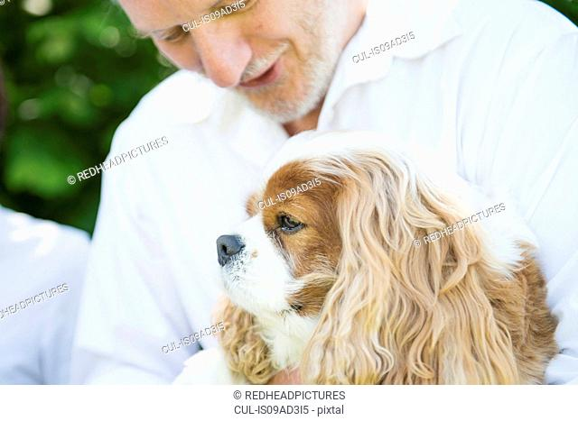 Senior man with pet dog