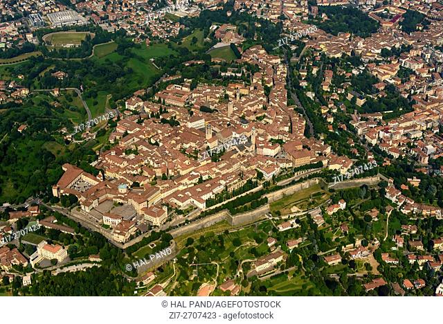 aerial shot, from a small plane, of south western side of city-walls and buildings in old high town of Bergamo, Lombardy , Italy