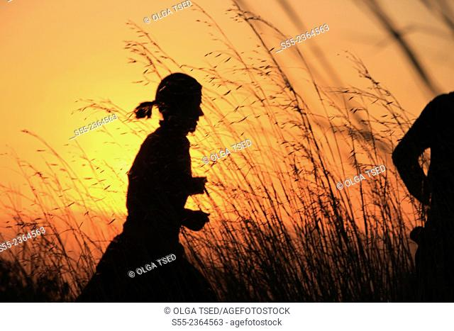 A woman running in the sunset in Collserola mountain. Barcelona, Catalonia, Spain