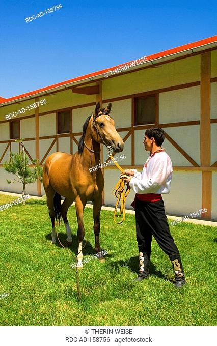 Man with Akhal-Teke horse stud farm Ashgabat Turkmenistan Asgabat