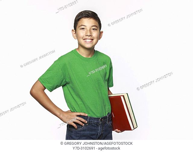 A conceptual education photo of a student holding school books