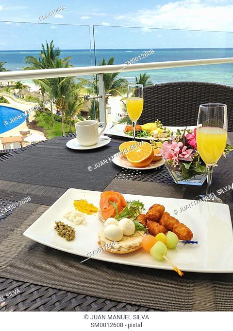 Breakfast on balcony by the sea