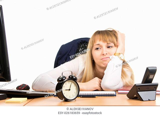 young beautiful business woman sitting at office desk working, isolated on white background