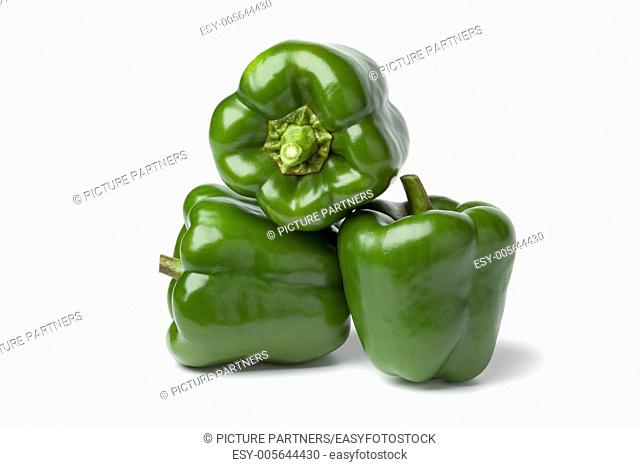 Green bell peppers on white background