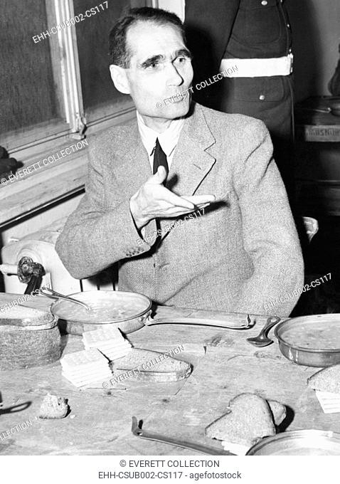 Rudolf Hess, Adolf Hitler's one time Deputy, taking a meal at Nuremberg prison. Soup, bread and crackers were on the menu for the Nazi defendants. Dec