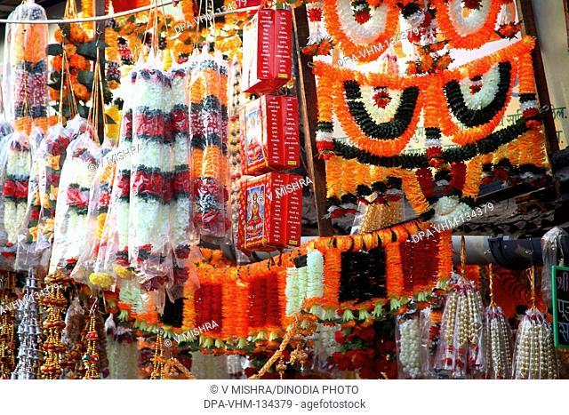 Indian Deepawali diwali festival ; sale of Plastic Toran Decorative Garland for the Door ; Mumbai Bombay ; Maharashtra ; India