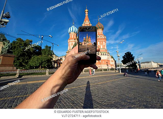 Taking picture with a mobile of St. Basil's Cathedral (Red Square, Moscow)