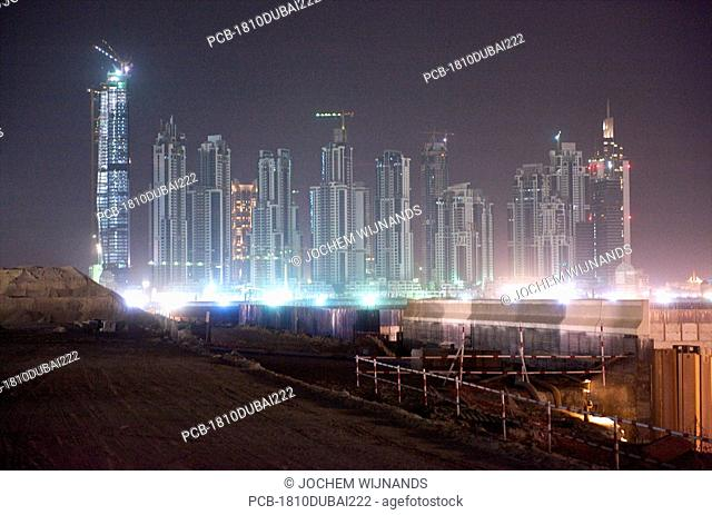 Dubai, building site at night, construction is going on 24/7