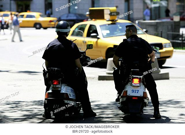 USA, United States of America, New York City: Police Patrol on motor-sooter at Central Park South