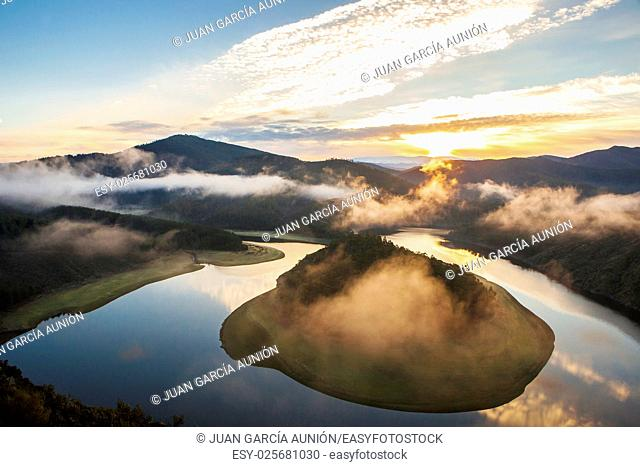 Misty sunrise at Alagon River Meander. This place is called The Melero and is not far from Riomalo de Abajo, Hurdes, Spain