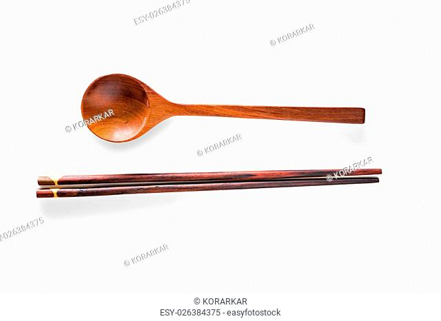 Wooden chopsticks and spoon isolated on white background