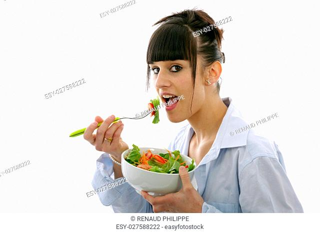 pretty young brunette woman eats salad