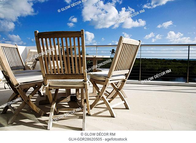 Chairs with a table in a balcony