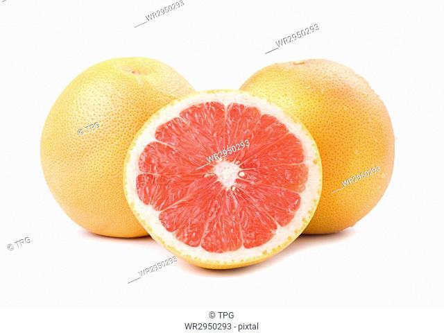Ripe grapefruit and slice isolated on white background