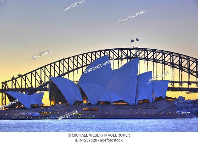 Sydney Opera House, Sydney Harbor Bridge at sunset, Sydney, New South Wales, Australia