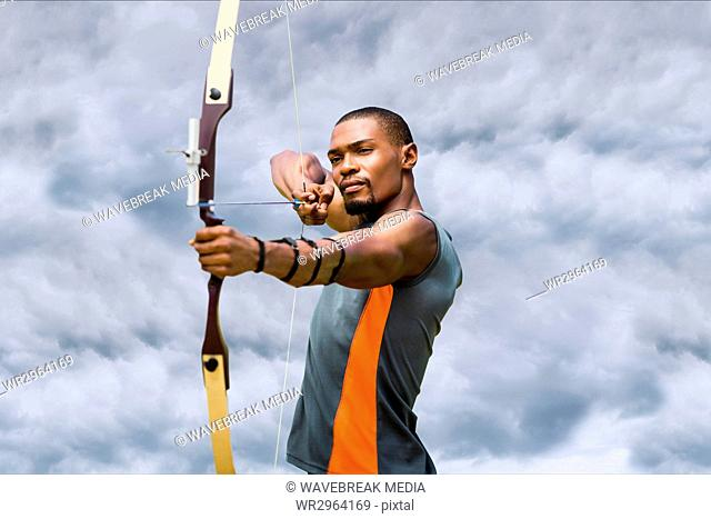 Archery player with a cloudy background