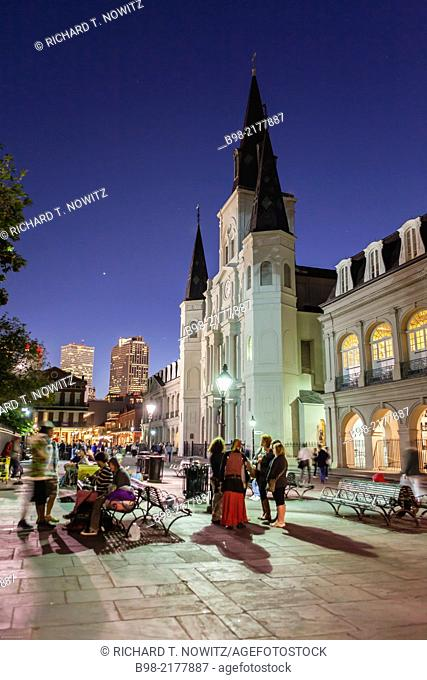 People enjoy the Nightlife in Jackson Square with the Saint Louis Cathedral in the background