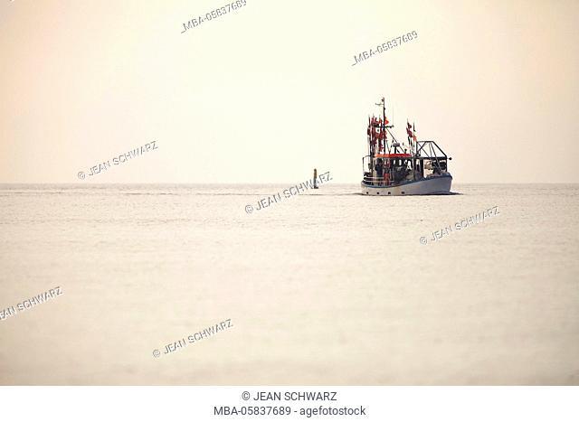 Fishing trawler in the sundown