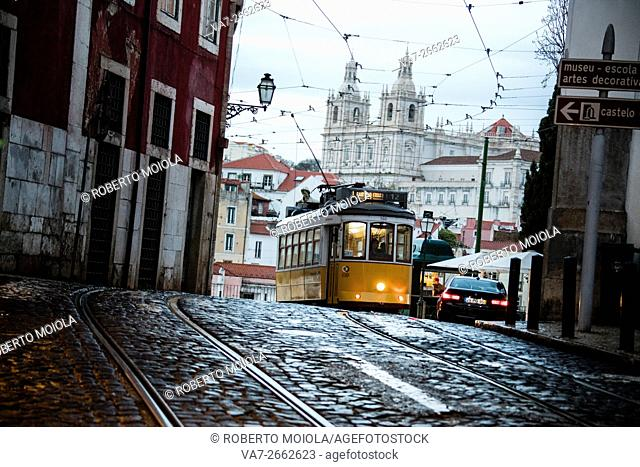 Romantic atmosphere in the old streets of Alfama with the castle in the background and tram number 28 Lisbon Portugal Europe