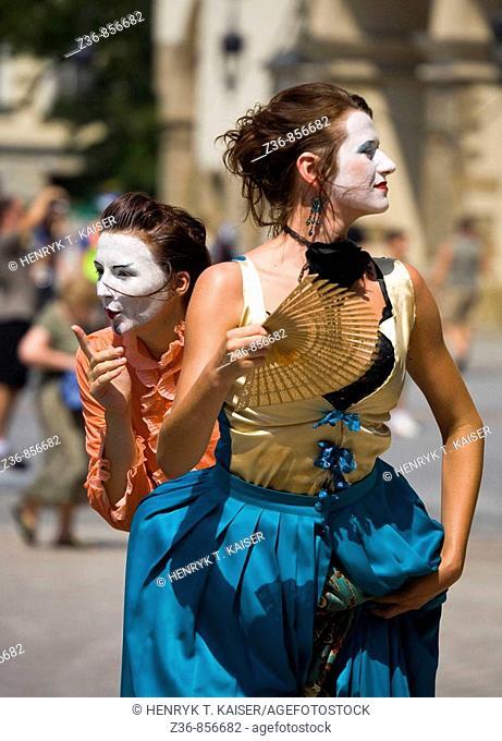 Women street performers at Main Market Square, Krakow, Poland