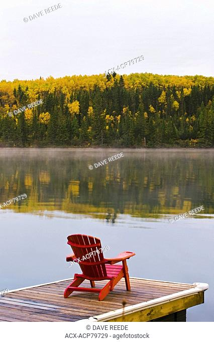 chair on dock, Clear Lake , Riding Mountain National Park, Manitoba, Canada