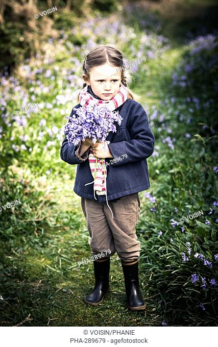 4-year-old girl holding a bouquet of wild flowers