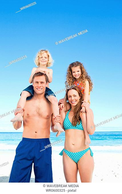 Cheerful family having a nice day on the beach