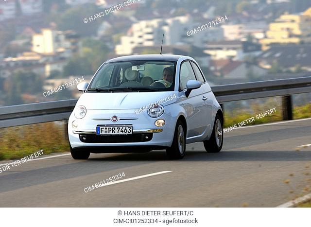 Fiat 500 1.4 16V Lounge, model year 2007-, white, driving, diagonal from the front, frontal view, country road