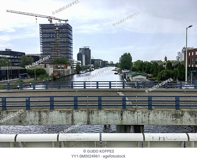 Amsterdam, Netherlans. View om the river Amstel, which gave the city it's name. As in any other city this size, lot's of constructionwork is going on