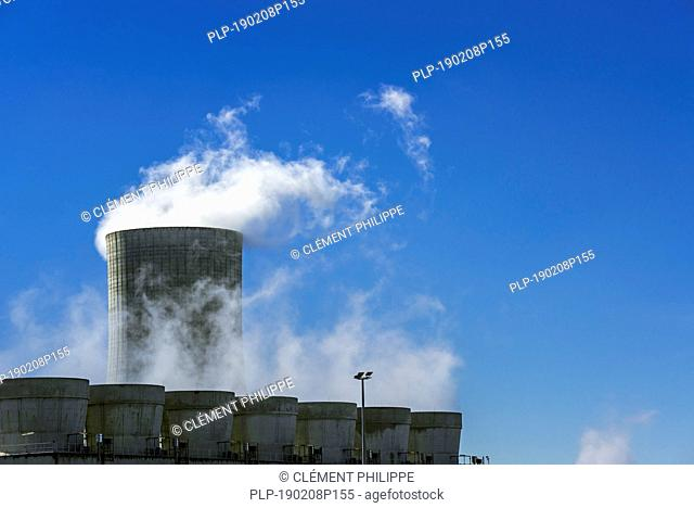 Industrial estate showing cooling tower and chimneys at the BASF chemical production site in the port of Antwerp, Belgium