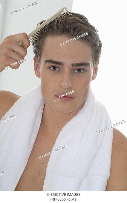 Man is combing his hair