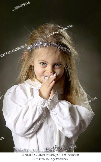 Young girl dressed for Lucia ceremony, Swedish cristmas tradition at the 13th of december