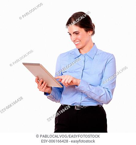 Portrait of an attractive stylish female, smiling while is working on a tablet pc, on isolated white background