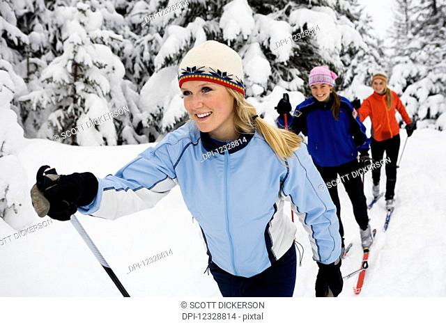 Three Young Women Cross Country Skiing, Ohlson Mountain; Alaska, United States Of America