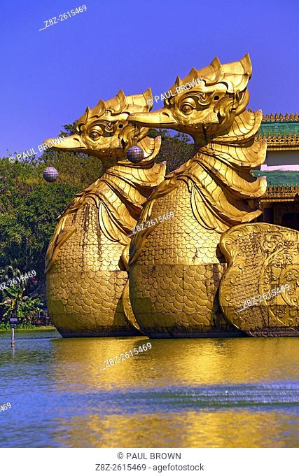 Karaweik Palace floating restaurant, Kandawgyi Lake, built in the shape of a Royal Barge, Yangon, Myanmar