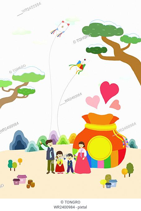 Background of traditional Korean holiday with happy family flying kites with a fortune bag