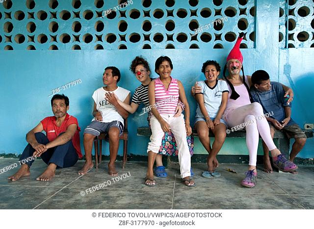 The clowns of Belen Festival are visiting C. R. E. M. I a center for mental diseases. Peru