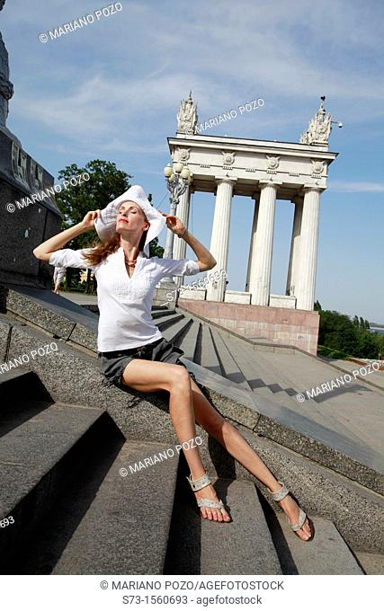 Woman poses in Volgograd, Colonnade on the central quay, Volvograd, Russian Federation
