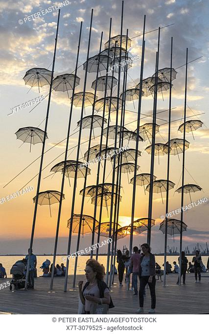 Georgios Zongolopoulos umbrellas sculpture at sunset on Thessaloniki waterfront, Macedonia, Northern Greece