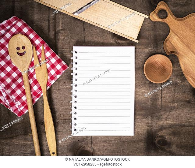 open paper notepad in line and kitchen accessories