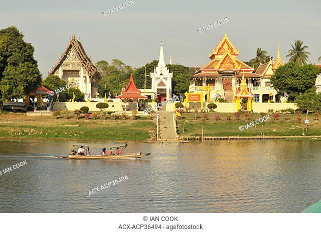 longtail sampan in Pa Sak River with Wat Monthop, Ayutthaya, Thailand